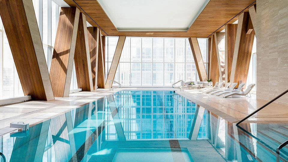a swimming pool with a wood ceiling